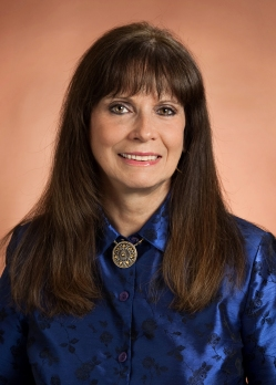 Real estate agent Sandi May of Brownstone Real Estate smiling for the camera
