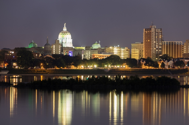 The Harrisburg State capital and skyline at night as seen from across the river.